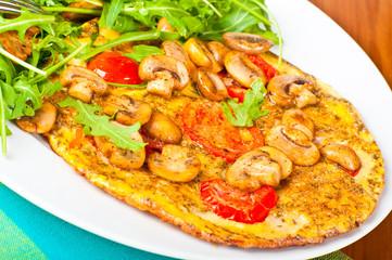 Tomato and mushroom omelette.