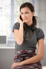 Young woman chatting on mobile at home