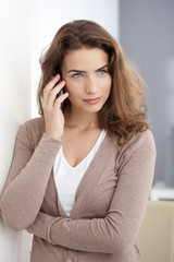 Attractive woman using mobile at home