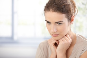 Portrait of pretty female thinking