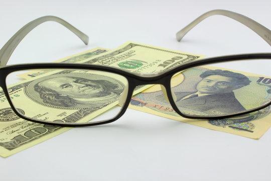 dollar bill and japanese yen
