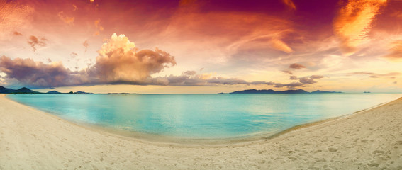 Panorama of tropical beach before sunset.