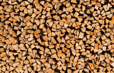 Holzstapel im Sonnenlicht - Background Image