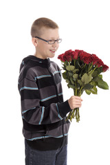 Mothers day : boy with bouquet of red roses