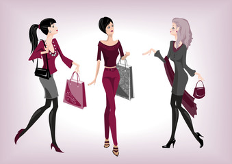 Three fashionable women going from shop