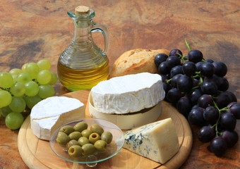Assortment of cheese on wooden board