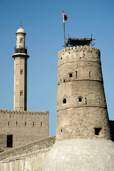 tower and minaret in old fort area of dubai