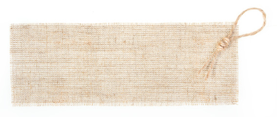 sackcloth tag with decor over white