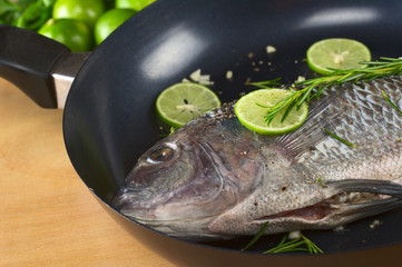 Raw tilapia with condiments