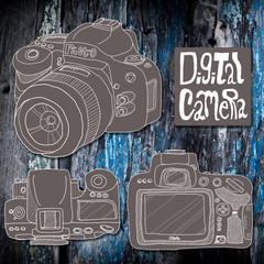 Digital slr camera sketch drawing on wooden background