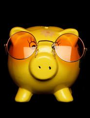 yellow piggybank with sunglasses