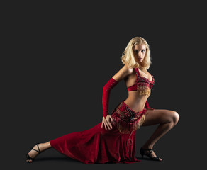 Beauty blond dancer - red oriental arabia costume