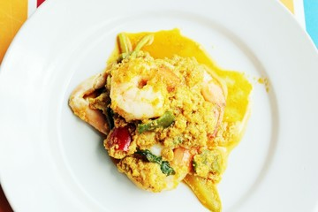 Thai sizzling wok curry shrimp, herb & spice.