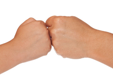 Fists of an adult and a child isolated on white