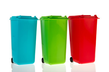 Three plastic roll containers