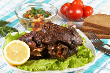 Roast leg of lamb on decorated table
