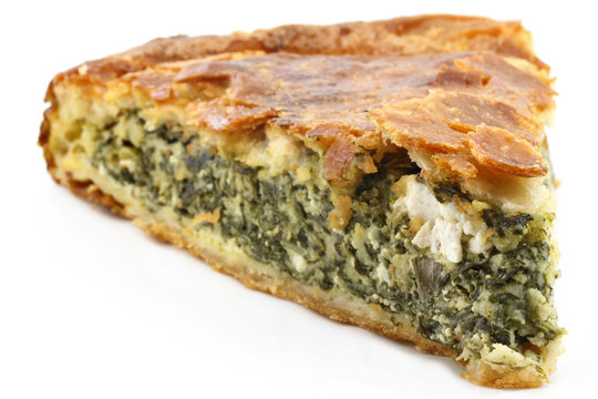 Traditional greek spinach pie ( spanakopita ) with goat cheese