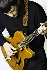 Guitar playing. Guitarist.