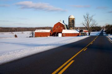 Red Barn Along Road in Winter