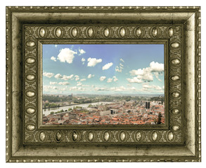 View over the red european roofs in beautiful vintage frame