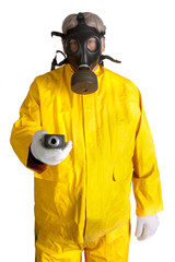 Man with geiger counter in gasmask and hazmat suit