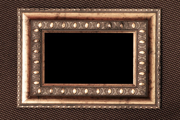 vintage metal frame over fabric texture