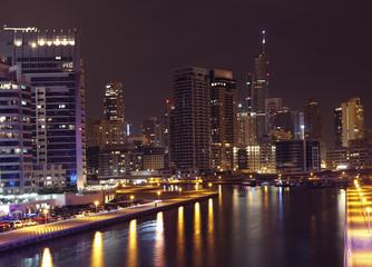 Town scape at night time. Panoramic scene, Dubai.