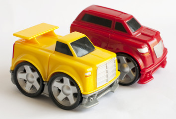 A childs yellow toy car red car to background isolated on white