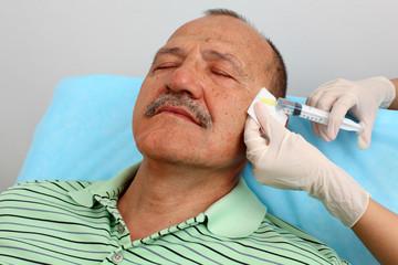 Men receiving syringe injection
