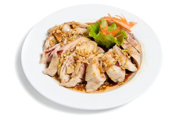 Roasted hen in sauce on a plate
