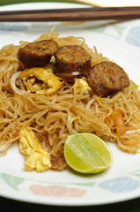 Stir fried noodle Thai style with Thai sausages