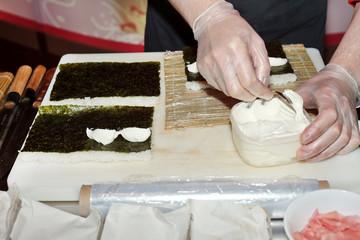 chef preparing sushi in the kitchen