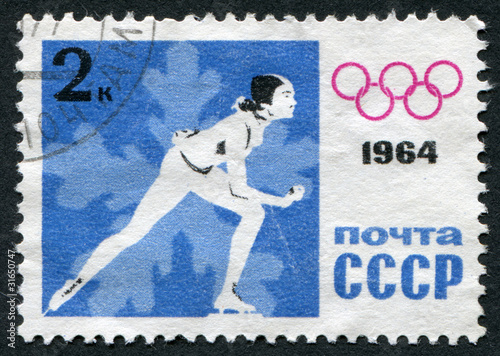 Postage stamp 1964: Man on the skates and the Olympic symbol