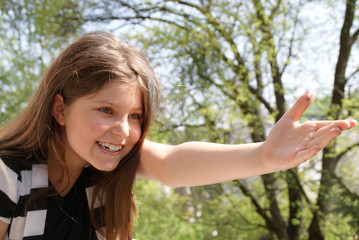 young girl pointing with her arm