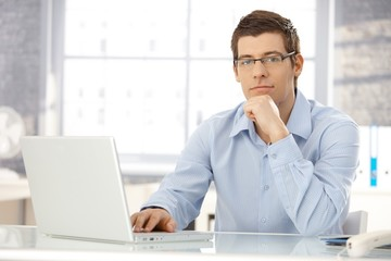 Portrait of office worker with laptop