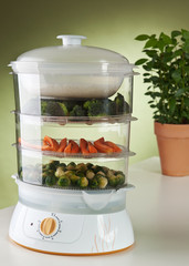 Vegetables and rice in food steamer