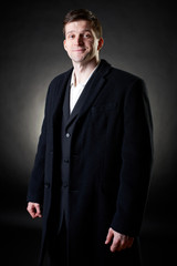 Elegant handsome young man on dark background