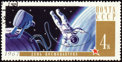 Postage stamp with Cosmonaut in open space