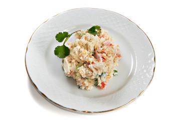 Crab salad of potatoes, crab sticks, corn, eggs and cucumber iso