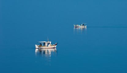 Two fishing boats in serene scene