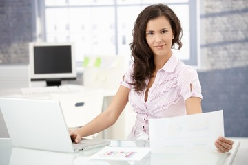 Young office worker smiling in bright office