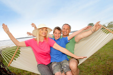 Portrait of family in a hammock