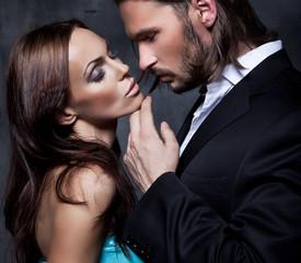 romantic portrait of the kissing couple