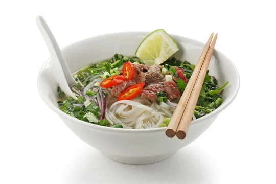 Pho bo , Vietnamese rice noodle soup with sliced rare beef