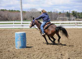 Young woman barrel racing