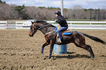 Young teenage girl barrel racing