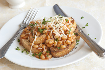 Toast with baked beans and grated cheese