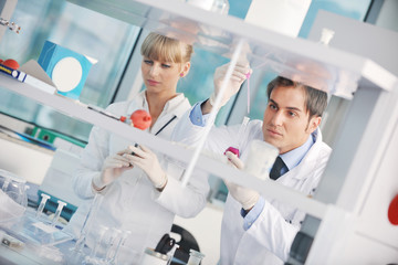 science people in bright lab