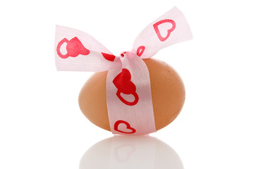 brown egg with  a  ribbon on white background