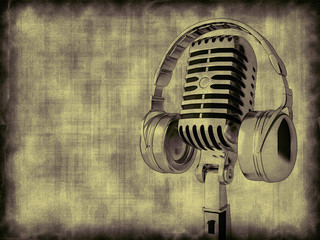Microphone with headphones on a gray background